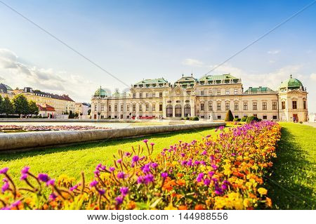 Beautiful view at Belvedere palace and nice flower arrangement in front Vienna Austria