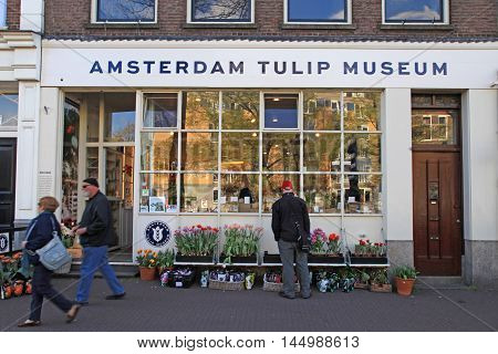 AMSTERDAM, NETHERLANDS - MAY 3, 2016: Unknown people in the front of the Amsterdam Tulip Museum, Amsterdam, Netherlands.