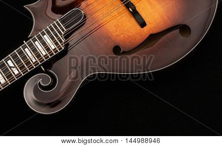 Wooden Mandolin isolated on black background. Music concept.