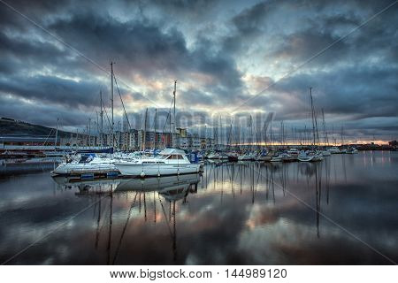 Cloud reflections in the early morning on the River Tawe and Swansea Marina