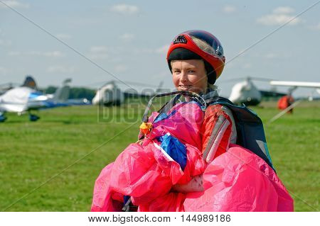 Kharkiv Ukraine - August 20 2016: Skydiver carries a parachute after landing at the airfield Korotych Kharkov region Ukraine on August 20 2016