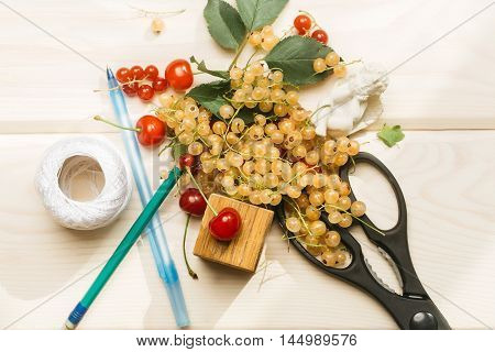 Pile Of White Currants With Scissors, Cherries And Pens