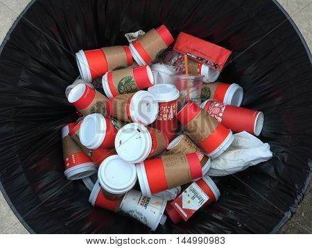 CHICAGO, ILLINOIS,, USA- Dec 23, 2015: A lot of coffee glasses in a trash at Millennium Park, Chicago, Illinois, USA