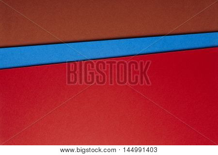 Colored cardboards background in brown blue red tone. Copy space. Horizontal