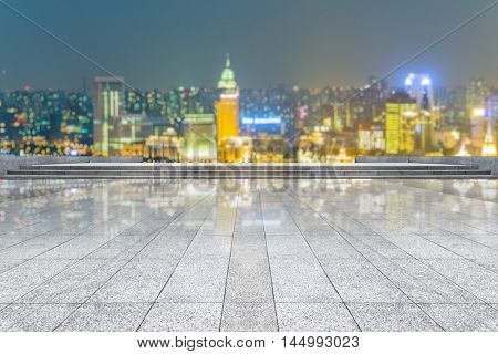 empty tiled floor with city skyline background