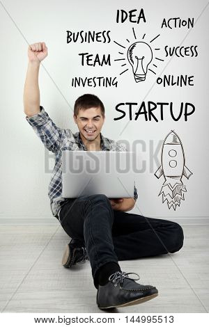 Young man using laptop on white background. Business trainer concept.