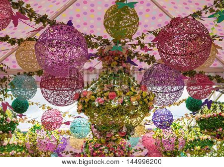Decorative composition of the colored balls and flower garlands