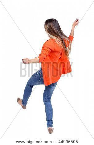 Balancing young woman. or dodge falling woman. girl in a red jacket slipped