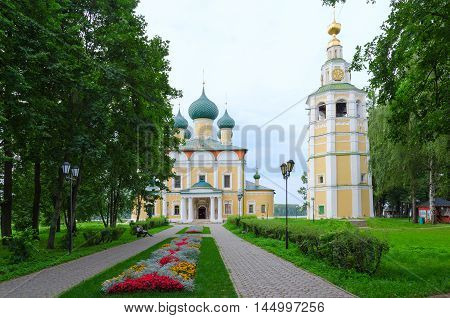 UGLICH RUSSIA - JULY 19 2016: Unidentified people are relaxing in park near Saviour Transfiguration Cathedral and belfry of Uglich Kremlin Russia