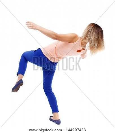 Balancing young woman. or dodge falling woman. Rear view people collection. blonde in a pink t-shirt falls on its side.
