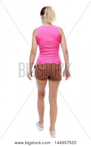 back view of walking woman. beautiful blonde girl in motion. Isolated over white background. Sport blond in brown shorts takes a step forward.