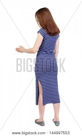 back view of woman shake hands. brunette in a blue striped dress holds out his hand for a handshake.