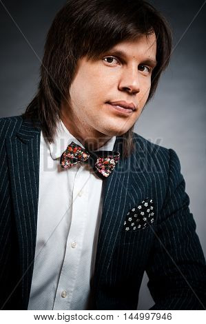 Handsome Man With Long Hair Brunette And Brown Eyes In Dark Suit