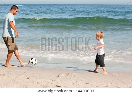 Father playing football with his son