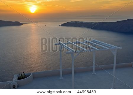 Amazing Sunset landscape in town of imerovigli, Santorini island, Thira, Cyclades, Greece