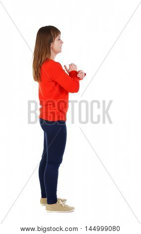 back view of standing young beautiful woman. girl in the red sweater is left side