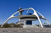 stock photo of lax  - Restaurant and control tower rise between terminals at Los Angeles International Airport - JPG