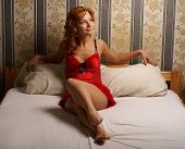 foto of moulin rouge  - Moulin Rouge lady on the bed - JPG