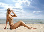 stock photo of monokini  - Sexy lady wearing swimsuit on the beach - JPG