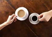 Photo of concept of male and female hands, love and coffee.