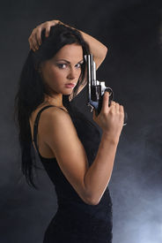 image of girls guns  - Sexy woman with weapon on smoky background - JPG