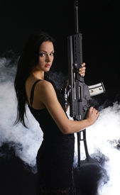 picture of girls guns  - Sexy woman with weapon on smoky background - JPG