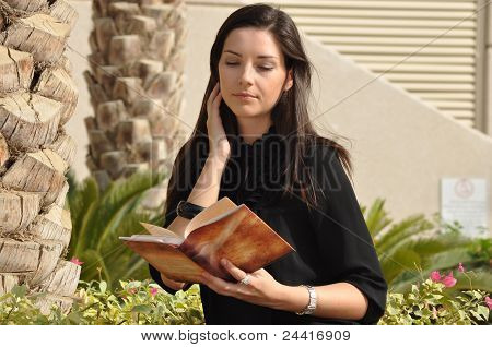 Young Beautiful Woman Reading