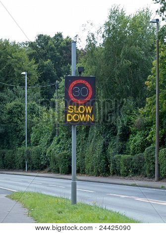 30 Slow Down sign