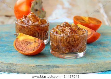persimmon fruit jam on wooden table
