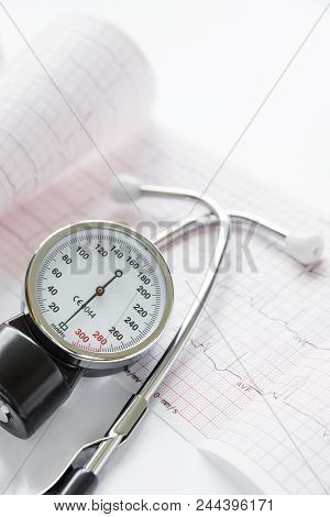 poster of Medical Concept: Stethoscope, Tonometer And Paper Cardiogram Are On A White Background. Vertical Ima