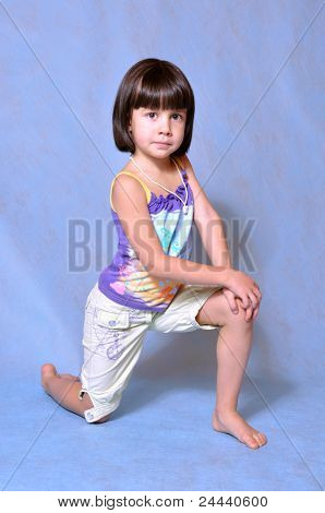 Little Girl Posing In Studio