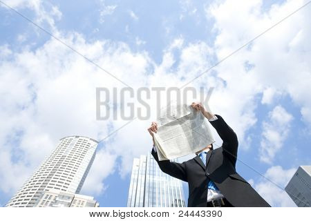 Businessman who reads newspaper