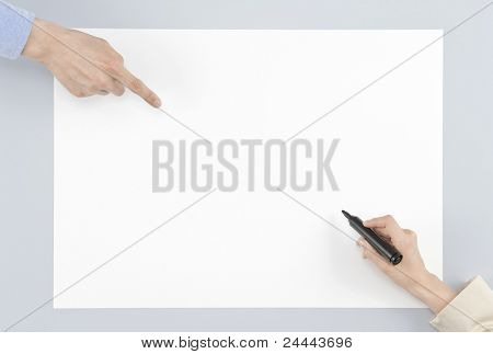 Hand with pen on white paper
