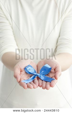 Blue ribbon put on hand