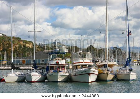 Boats Tied Together In A Harbor