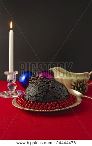 Christmas Pudding And Candle