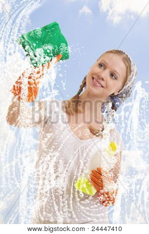 Young Woman Washing Window