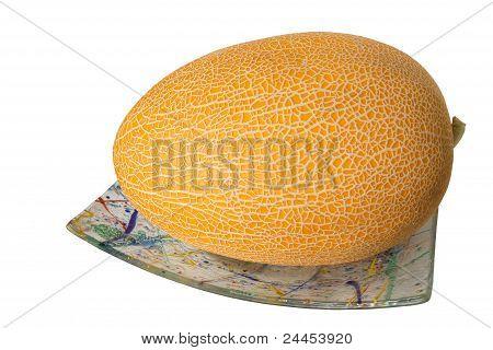 Die Zuckermelone auf der Platte, Isolated On White Background