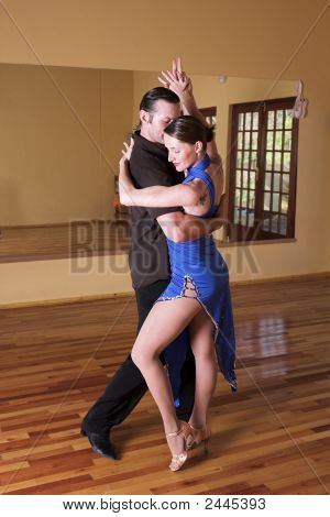Two Ballroom Dancers Practicing In Their Studio