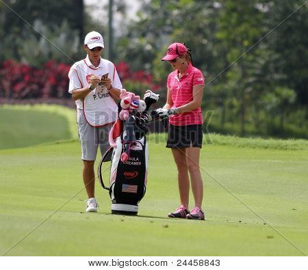 KUALA LUMPUR, MALAYSIA - OCTOBER 16: Paula Creamer of the USA discusses with her caddie on day 4 of the Sime Darby LPGA Malaysia 2011 golf tournament on Oct 16, 2011 in Kuala Lumpur, Malaysia.