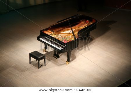 Piano With Bouquet Of Flowers On Scene