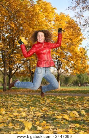 Girl In The Red Jacket Jumps In The Park