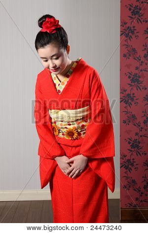 Bowing Respect By Asian Woman In Japanese Kimono