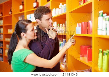 Couple Shopping In Pharmacy