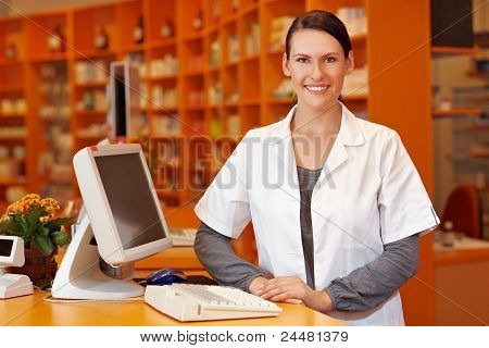 Pharmacist Standing At Checkout