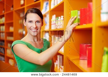 Happy Woman Shopping In Drugstore