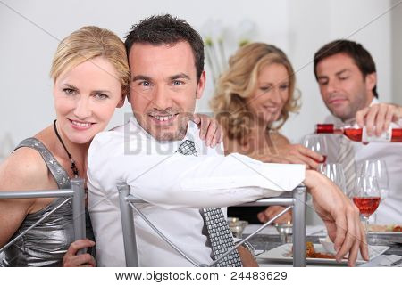 Couple dining with friends
