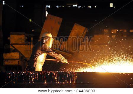 worker using torch cutter