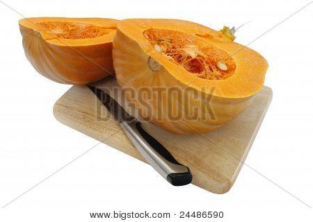Calabaza en rodajas y cuchillo