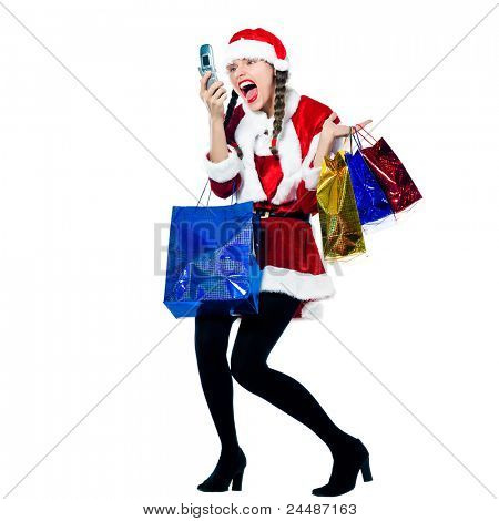 one woman dressed as santa claus carrying screaming on the telephone christmas bags  on studio isolated white background